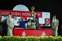 Bill Casner (WinStar Farm) hoists the Dubai World Cup as presented by Sheikh Mohammed bin Rashid Al Maktoum, Vice-President of the UAE and Ruler of Dubai