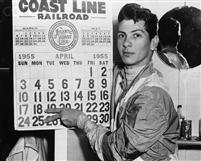 Jockey Bill Hartack has reason to point with pride as he indicates his two big days, April 18 and April 25 at Laurel. Hartack was aboard six winners in seven races at Laurel on the 25th, and on April 18 he rode five consecutive winners plus two seconds in seven races. April 29, 1955.