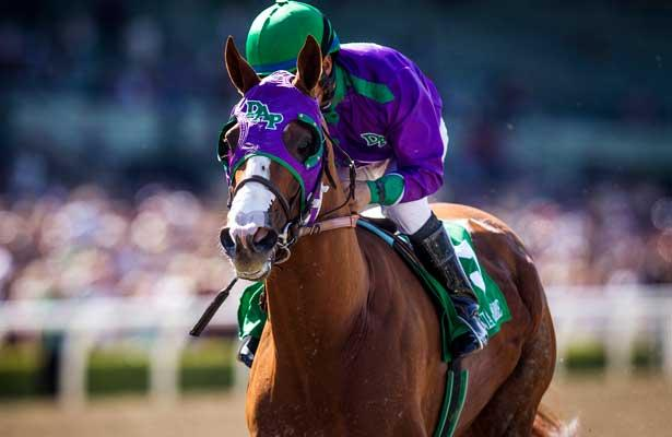 APRIL 5, 2014: California Chrome, ridden by Victor Espinoza wins the Santa Anita Derby at Santa Anita Park in Arcadia CA. Alex Evers/ESW/CSM