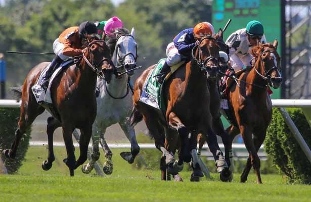 June 7, 2014: Coffee Clique with Javier Castellano aboard wins the Grade I Longines Just A Game at Belmont Park in Elmont, New York. Zoe Metz/ESW/CSM