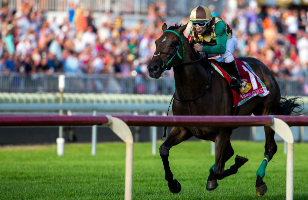 Hardest Core wins the 2014 Arlington Million, jockey Eriluis Vaz, trainer Edward Graham, owned by Andrew Bentley