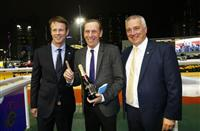 The Hong Kong Jockey Club's Executive Director, Racing Authority, Mr. Andrew Harding (left) and Executive Director, Racing Business and Operations, Mr. Anthony Kelly (right), present a commemorative bottle of champagne to trainer John Size (centre), celebrating his 1000th Hong Kong win with Game Of Fun.
