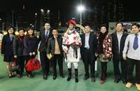 Nash Rawiller celebrates with trainer Me Tsui and connections after Excel Oneself gave the rider the first leg of a treble.