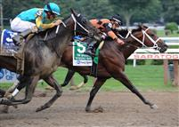 Poseidon's Warrior (#5) and jockey Irad Ortiz, Jr. winning the Grade 1, $400,000 Alfred G. Vanderbilt Handicap.