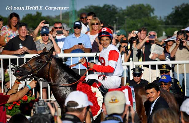 Real SOlution in the Winner's Circle after winning the 2013 Arlington Million