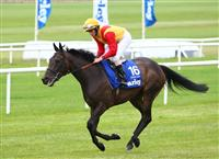 Snow Fairy with jockey Ryan Moore wins the Darley Irish Oaks at Curragh Racecourse.