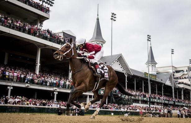 Untapable wins the 2014 Kentucky Oaks with jockey Rosie Napravnik for trainer Steve Asmussen and owners Winchell Thoroughbreds, LLC.