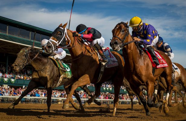 Whitmore #11, ridden by Manny Franco defeats Awesome Banner #1 with Jose Lezcano and Limousine Liberal #5 with Jose Ortiz to win the Stoll Keenon Ogden Phoenix at Keeneland Race Course on October 06, 2017 in Lexington, Kentucky.