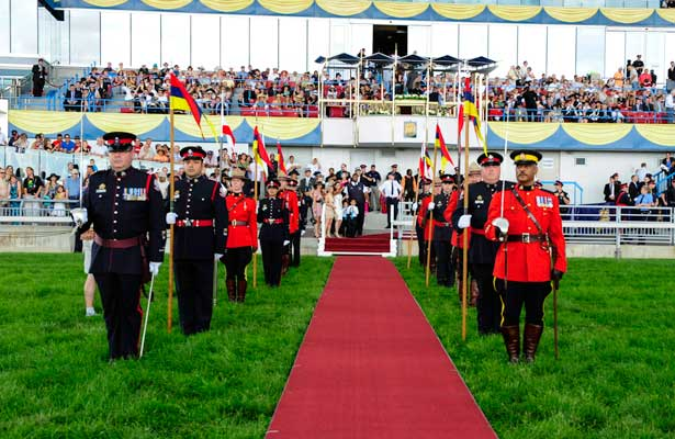 The Honour Guard awaits the arrival of the Governor General at Queen's Plate at Woodbine Raceway in Toronto, Canada on July 07, 2013.