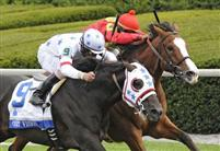 Court Vision outfinishes Karelian Shadwell Turf Mile.