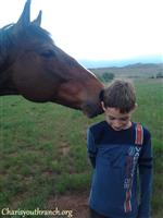 """Mort"" no longer runs races, but he ""races"" into kids hearts on the youth ranch where he is retired."